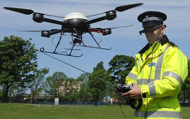 Police aerial surveillance drone...PC Derek Charlton of Merseyside Police operates their new aerial surveillance drone in Liverpool. PRESS ASSOCIATION Photo. Picture date: Monday May 21, 2007. The remote control helicopter, fitted with CCTV cameras, will be used by officers in Merseyside to track criminals and record anti-social behaviour. See PA story POLICE Drone. Photo credit should read: John Giles/PA Wire